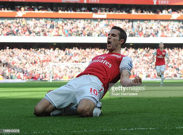 Robin van Persie celebrates scoring the 2nd Arsenal goal during the Barclays Premier League match between Arsenal and Tottenham Hotspur at Emirates...