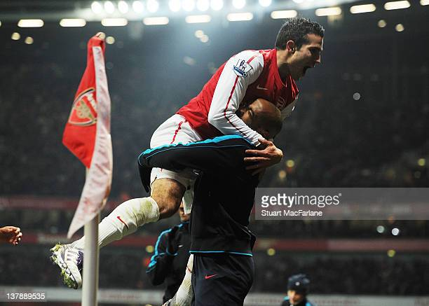 Robin van Persie celebrates scoring the 3rd Arsenal goal with substitute Thierry Henry during the FA Cup Fourth Round match between Arsenal and Aston...