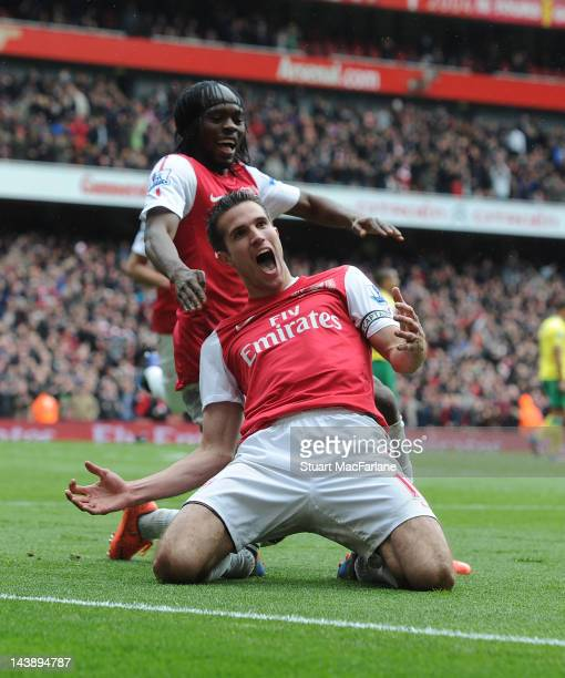 Robin van Persie celebrates scoring the third Arsenal goal during the Barclays Premier League match between Arsenal and Norwich City at Emirates...