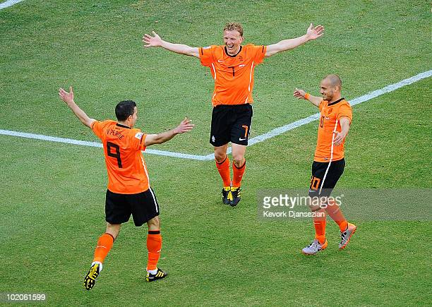 Robin Van Persie Dirk Kuyt and Wesley Sneijder of the Netherlands celebrate the own goal by Simon Poulsen during the 2010 FIFA World Cup Group E...
