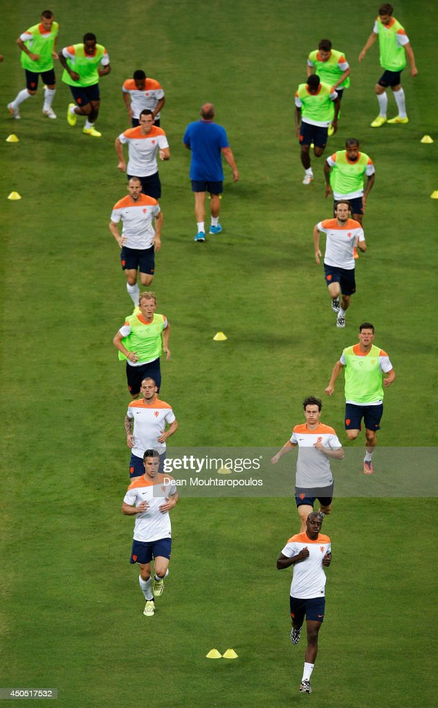 Robin van Persie (bottom left) leads the runners during the Netherlands training session ahead of the 2014 FIFA World Cup Group B match between Spain and the Netherlands held at the Arena Fonte Nova on June 12, 2014 in Salvador, Brazil.