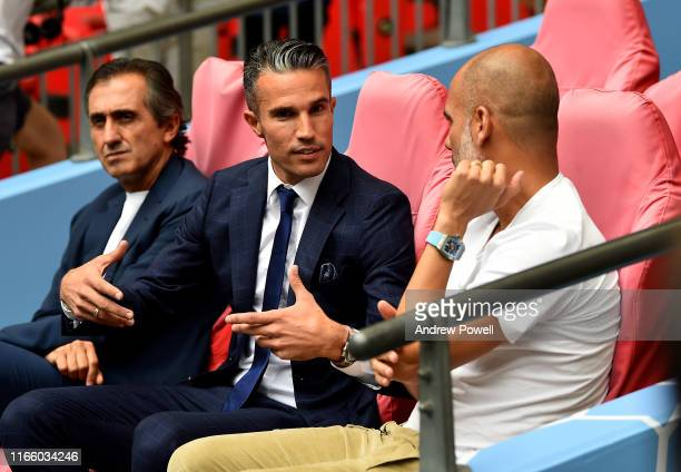 Robin van Persie meets Pep Guardiola of Man city beforte the FA Community Shield match between Liverpool and Manchester City at Wembley Stadium on...