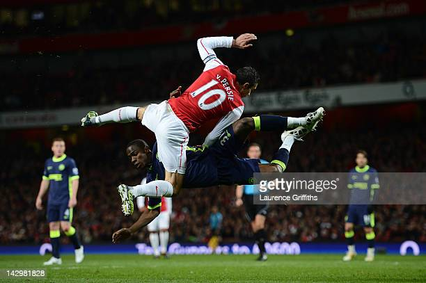 Robin van Persie of Arsenal and Maynor Figueroa of Wigan fight for the ball during the Barclays Premier League match between Arsenal and Wigan...
