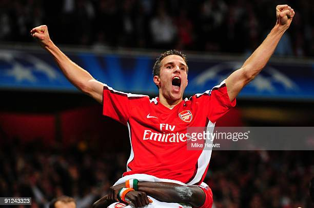 Robin van Persie of Arsenal celebrates after he scored the first goal during the UEFA Champions League Group H match between Arsenal and Olympiakos...