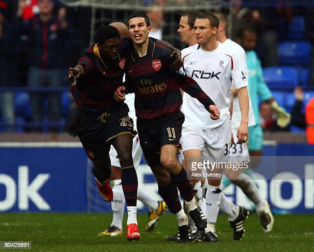 Robin van Persie of Arsenal celebrates after he scores a penalty with team mate Emmanuel Adebayor during the Barclays Premiership match between...