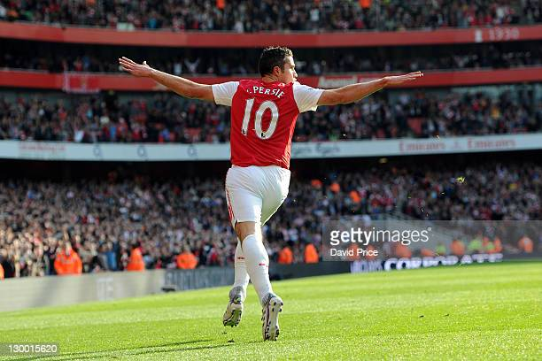 Robin van Persie of Arsenal celebrates after scoring his first goal Arsenal's second during the Barclays Premier League match between Arsenal and...