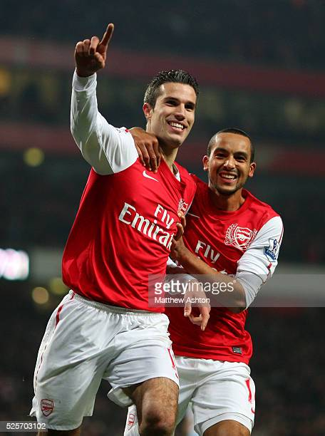 Robin van Persie of Arsenal celebrates after scoring to make it 32 with Theo Walcott of Arsenal