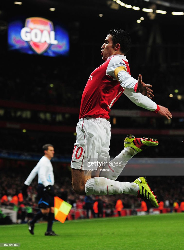 Robin van Persie of Arsenal celebrates as he scores their first goal from the penalty spot during the UEFA Champions League Group H match between Arsenal and FK Partizan Belgrade at the Emirates Stadium on December 8, 2010 in London, England.