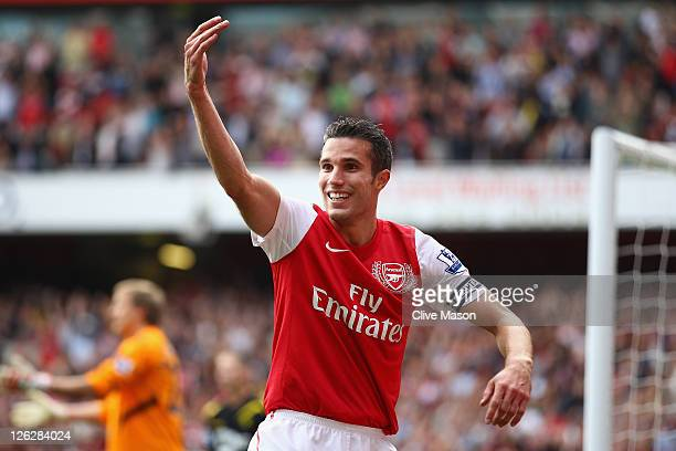 Robin Van Persie of Arsenal celebrates his second goal during the Barclays Premier League match between Arsenal and Bolton Wanderers at Emirates...