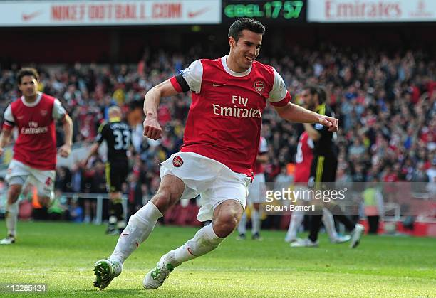 Robin van Persie of Arsenal celebrates scoring a penalty kick during the Barclays Premier League match between Arsenal and Liverpool at the Emirates...