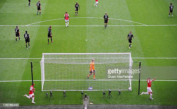 Robin van Persie of Arsenal celebrates scoring his 2nd goal of the match and his 100th goal for Arsenal during the Barclays Premier League match...