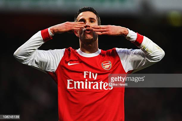 Robin Van Persie of Arsenal celebrates scoring his sides second goal during the Barclays Premier League match between Arsenal and Wigan Athletic at...
