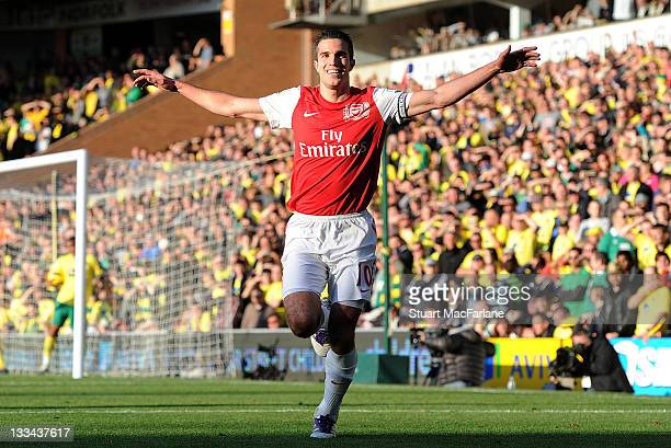 Robin van Persie of Arsenal celebrates scoring his team's second goal during the Barclays Premier League match between Norwich City and Arsenal at...