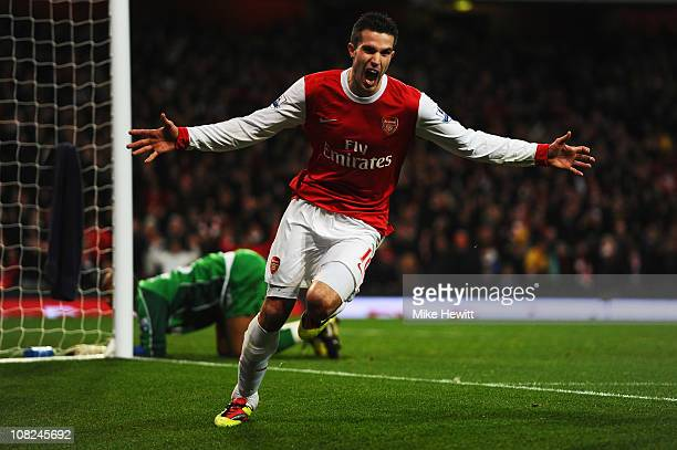 Robin Van Persie of Arsenal celebrates scoring his third goal in a hat trick during the Barclays Premier League match between Arsenal and Wigan...