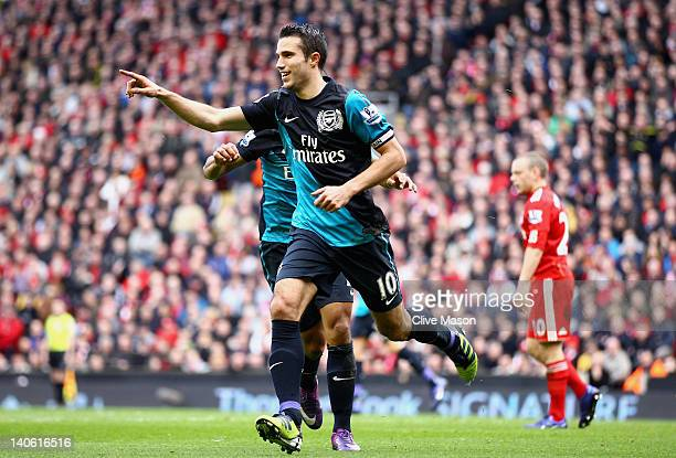 Robin van Persie of Arsenal celebrates scoring the equalising goal during the Barclays Premier League match between Liverpool and Arsenal at Anfield...