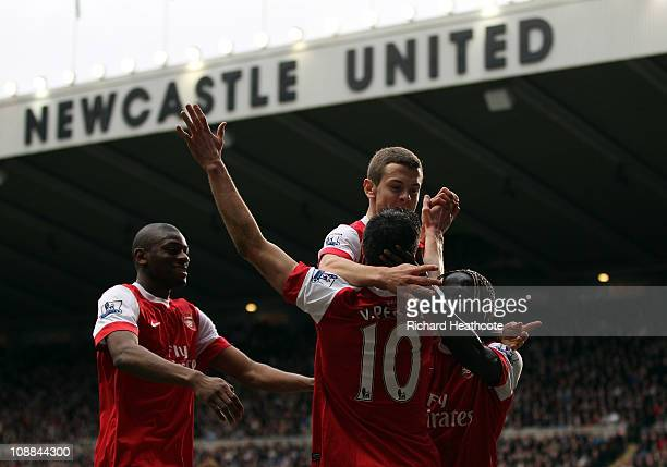 Robin Van Persie of Arsenal celebrates scoring the fourth goal during the Barclays Premier League match between Newcastle United and Arsenal at St...