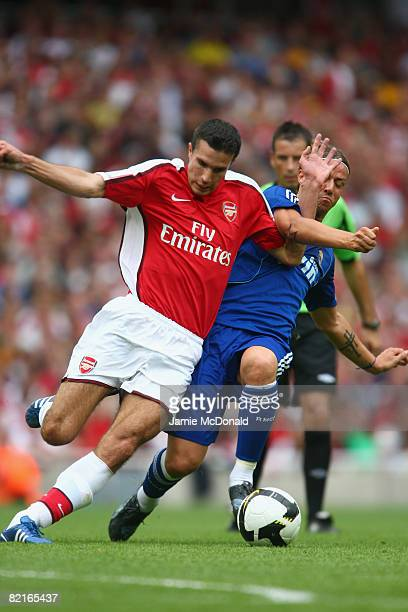 Robin Van Persie of Arsenal competes for the ball with Guti of Real Madrid during the preseason friendly match between Arsenal and Real Madrid during...