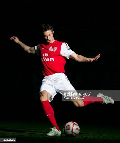 Robin van Persie of Arsenal FC poses in the Arsenal home kit for the 2011/2012 season at their London Colney training ground on April 8 2011 in St...