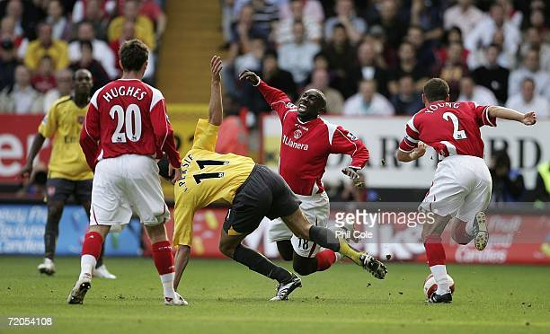 Robin Van Persie of Arsenal get a Yellow card after this tackle against Jimmy Floyd Hasselbaink of Charlton during the Barclay's Premiership match...
