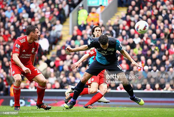 Robin van Persie of Arsenal heads the ball and scores the equalising goal during the Barclays Premier League match between Liverpool and Arsenal at...