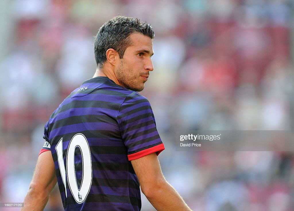 Robin van Persie of Arsenal in action against FC Cologne during Pre-Season Friendly game at Rhein Energie Stadium on August 12, 2012 in Cologne, Germany.