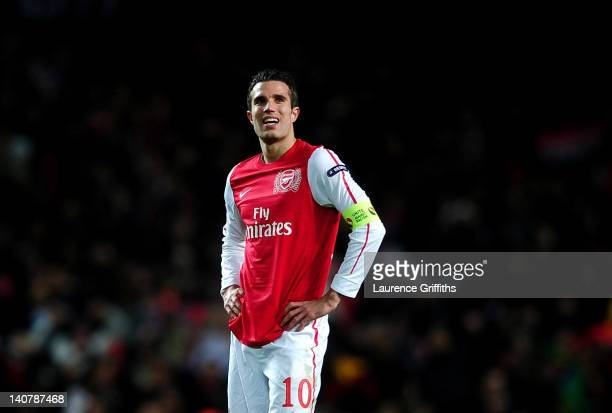 Robin van Persie of Arsenal looks on dejected at the final whistle during the UEFA Champions League Round of 16 second leg match between Arsenal and...