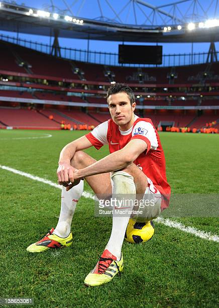Robin van Persie of Arsenal poses for a portrait after scoring two goals to secure victory over Wolverhampton Wanderers at Emirates Stadium on...