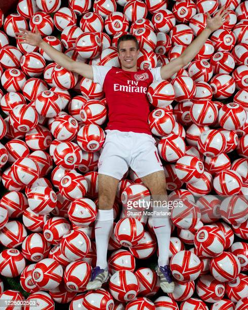 Robin van Persie of Arsenal poses in a of balls during an Arsenal Magazine photoshoot on October 13 2011 in St Albans England