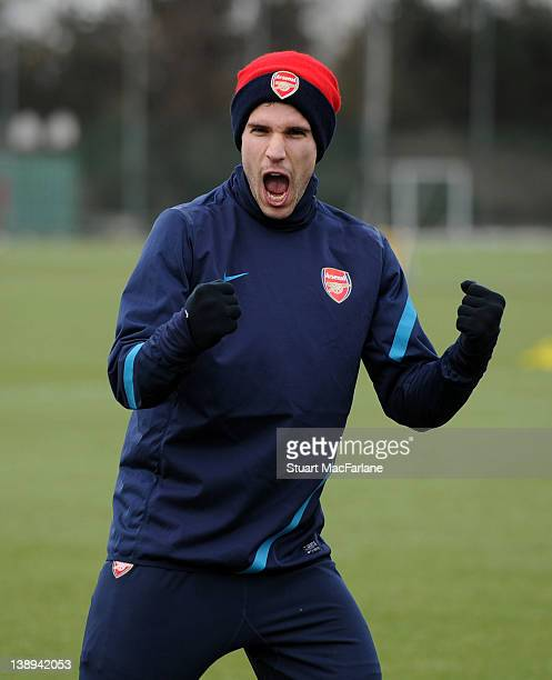 Robin van Persie of Arsenal reacts during a training session at London Colney on February 14, 2012 in St Albans, England.