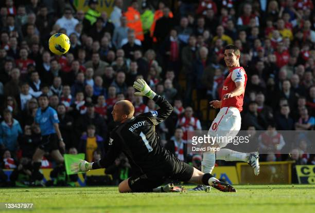 Robin van Persie of Arsenal scores his team's second goal past John Ruddy of Norwich at Carrow Road on November 19 2011 in Norwich England