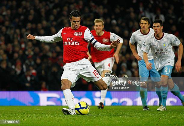 Robin van Persie of Arsenal scores their third goal from the penalty spot during the FA Cup with Budweiser Fourth Round match between Arsenal and...