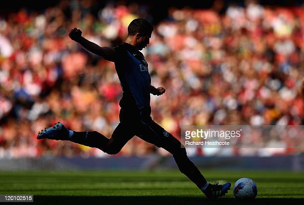 Robin van Persie of Arsenal takes a free kick during the Emirates Cup match between Arsenal and Boca Juniors at the Emirates Stadium on July 30 2011...