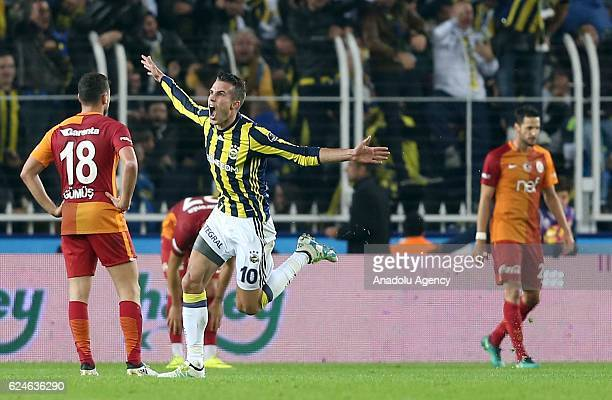 Robin Van Persie of Fenerbahce celebrates after scoring a goal during the Turkish Spor Toto Super Lig match between Fenerbahce and Galatasaray at...