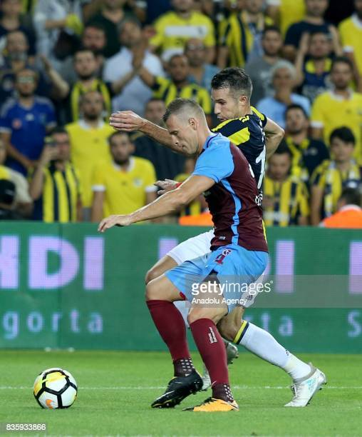 Robin Van Persie of Fenerbahce vies with Jan Durica during Turkish Super Lig soccer match between Fenerbahce and Trabzonspor at the Ulker Stadium in...