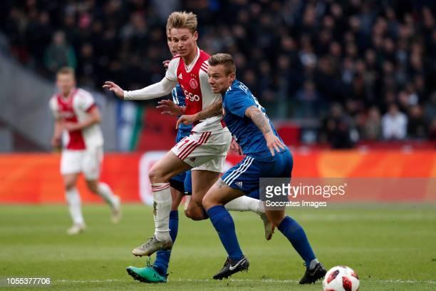 Robin van Persie of Feyenoord Frenkie de Jong of Ajax Jordy Clasie of Feyenoord during the Dutch Eredivisie match between Ajax v Feyenoord at the...