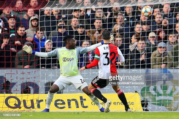 Robin Van Persie of Feyenoord scores his side's fourth goal during the Eredivisie match between Feyenoord and Ajax at De Kuip on January 27, 2019 in...
