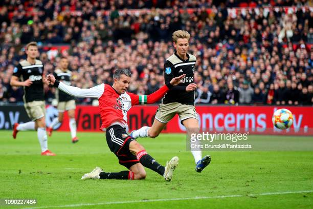 Robin Van Persie of Feyenoord scores his side's third goal during the Eredivisie match between Feyenoord and Ajax at De Kuip on January 27, 2019 in...