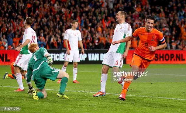 Robin van Persie of Holland celebrates after scoring their fifth goal during the FIFA 2014 World Cup Qualifing match between Holland and Hungary at...