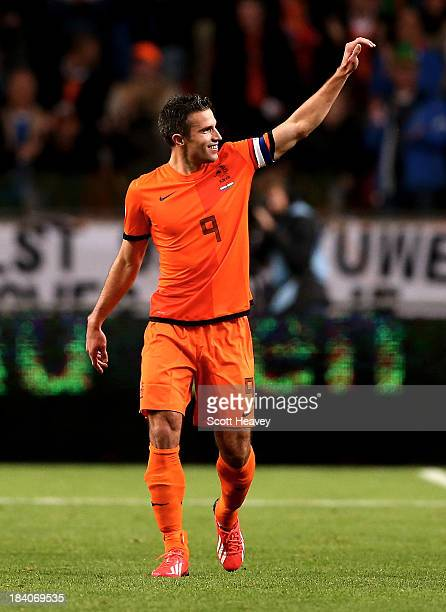 Robin van Persie of Holland celebrates after scoring their first goal during the FIFA 2014 World Cup Qualifing match between Holland and Hungary at...