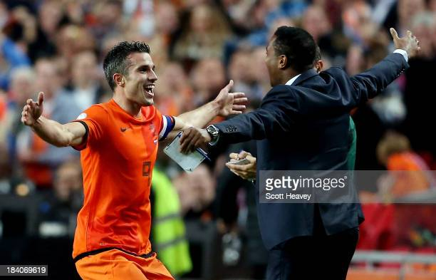 Robin van Persie of Holland celebrates with Patrick Kluivert after scoring their fourth goal during the FIFA 2014 World Cup Qualifing match between...