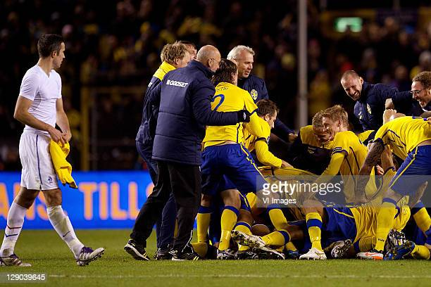 Robin van Persie of Holland, Rasmus Elm of Sweden during the EURO 2012 Qualifying match between Sweden and Netherlands at the Rasunda stadium on...