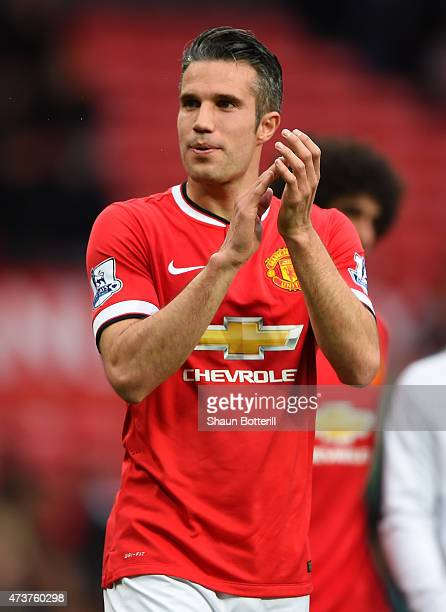Robin van Persie of Manchester United applauds the crowd after the Barclays Premier League match between Manchester United and Arsenal at Old...