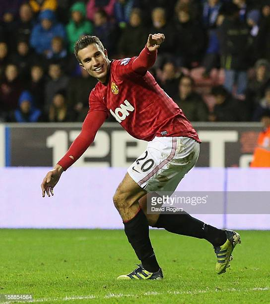 Robin van Persie of Manchester United celebrates after scoring his second goal during the Barclays Premier League match between Wigan Athletic and...