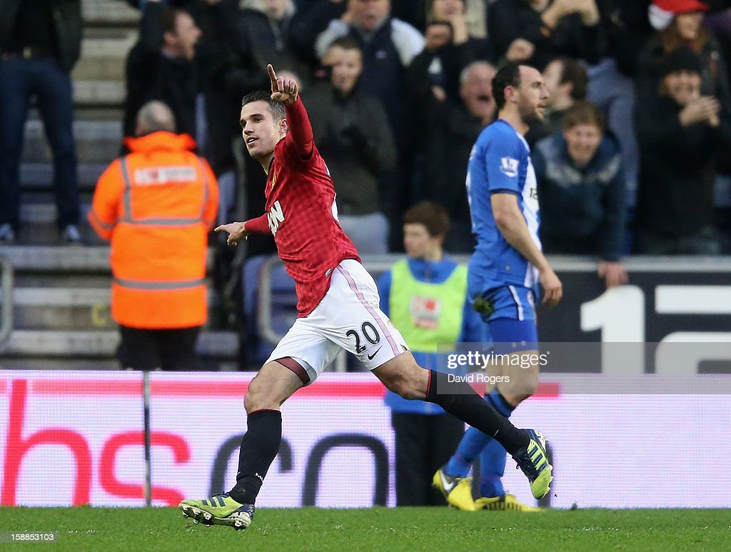 Robin van Persie of Manchester United celebrates after scoring the second goal during the Barclays Premier League match between Wigan Athletic and Manchester United at the DW Stadium on January 1, 2013 in Wigan, England.