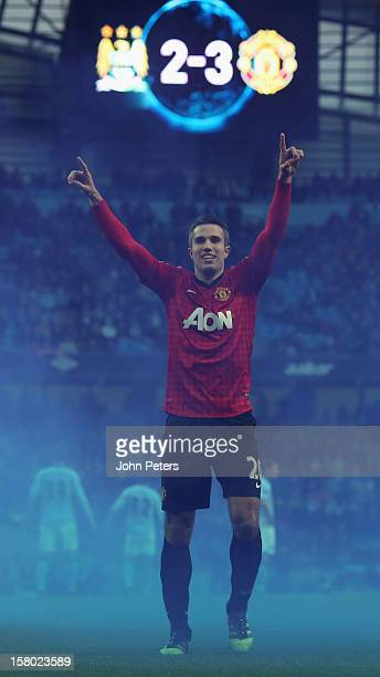 Robin van Persie of Manchester United celebrates at the end of the Barclays Premier League match between Manchester City and Manchester United at...