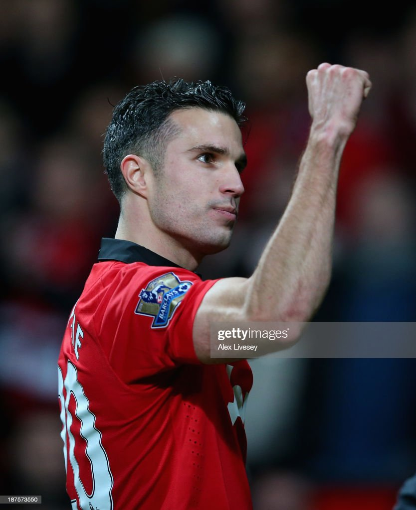 Robin van Persie of Manchester United celebrates at the end of the Barclays Premier League match between Manchester United and Arsenal at Old Trafford on November 10, 2013 in Manchester, England.