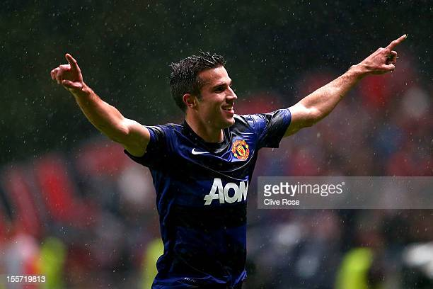 Robin van Persie of Manchester United celebrates his goal during the UEFA Champions League Group H match between SC Braga and Manchester United at...