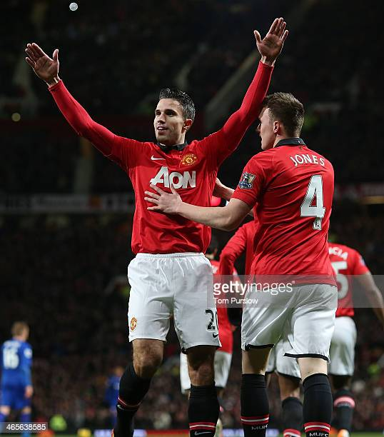 Robin van Persie of Manchester United celebrates scorin their first goal during the Barclays Premier League match between Manchester United and...