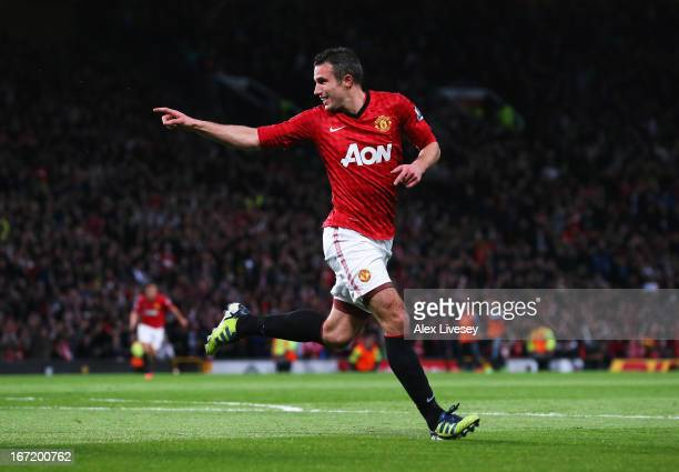Robin van Persie of Manchester United celebrates scoring his hat trick goal during the Barclays Premier League match between Manchester United and...