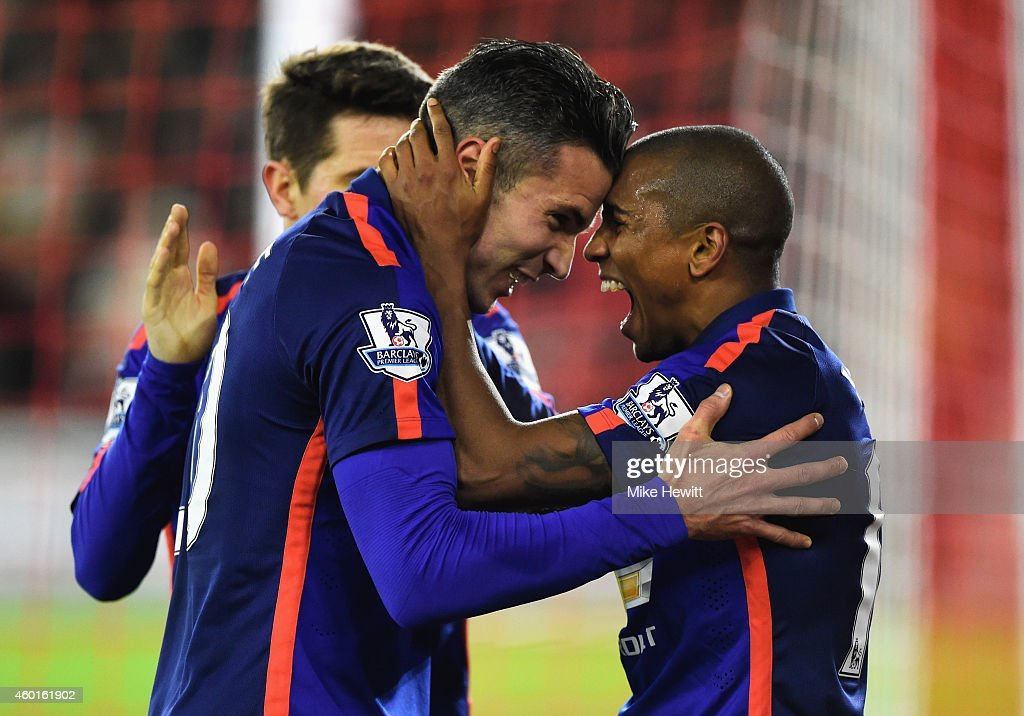 Robin van Persie of Manchester United celebrates scoring his second goal with Ashley Young of Manchester United during the Barclays Premier League match between Southampton and Manchester United at St Mary's Stadium on December 8, 2014 in Southampton, England.